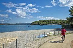 Gulf of porec. By bicycle on the waterfront of the Gulf of Porec Royalty Free Stock Photos