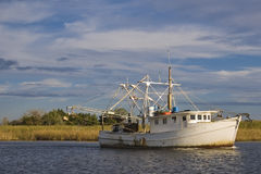 Gulf Shrimper. A shrimboat heading out to the Gulf of Mexico Royalty Free Stock Photography