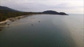 Gulf of Thailand`s coast aerial bird`s eye view, with the boat rolling on the placid sea stock video footage