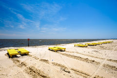 Gulfport Beach. Gulf coast beach in Gulfport, Mississippi with lounge chairs along the shoreline Stock Image