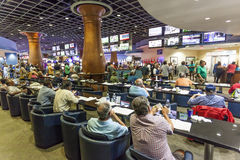 Gulfstream Casino in Hallandale Beach, Florida. HALLANDALE BEACH, USA - MAR 11, 2017: People betting and gambling in the Gulfstream park casino in Hallandale Stock Images