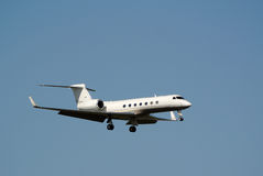Gulfstream V business jet. A gulfstream V business jet is shown on approach to Punta Gorda FL KPGD Royalty Free Stock Photo
