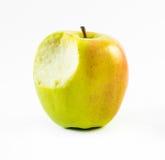 Guling biten övre sikt för äppleslut på en vit bakgrund royaltyfria foton