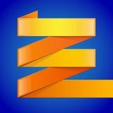 Guling och orange glansigt papper vek på bandet Arkivbild