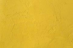 Guling texturerad vägg. bakgrund Arkivbild