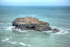 Gull Rock Portreath North Cornwall England UK between St Agnes and Godrevy in HDR Royalty Free Stock Photo