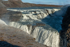 Gullfoss Falls in Iceland. One of the most Famous Falls in Iceland. Snowy Ground. Stock Photo