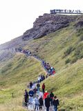 Eople on path to viewpoint of Gullfoss waterfall. GULLFOSS, ICELAND - SEPTEMBER 6, 2017: people on path to viewpoint of Gullfoss waterfall. Gullfoss is located Stock Photo