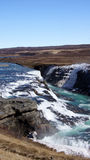 Gullfoss icy waterfall in Iceland. The icy Gullfoss waterfall and rainbow in the Hvita (white) river in spring in Iceland Stock Photo
