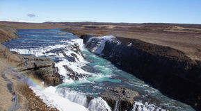 Gullfoss icy waterfall and rainbow. The icy Gullfoss waterfall and rainbow in the Hvita (white) river in spring in Iceland Royalty Free Stock Image