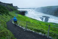 Tourist on a trip near the Gullfoss waterfall in Iceland Royalty Free Stock Photography