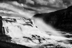 Gullfoss waterfall with a rainbow in black and white. Fine Art, Black and White, Long exposure photograph of a waterfall in Gulfoss, in Iceland Stock Photo