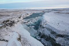 Gullfoss waterfall during winter in Iceland blue and cold.