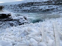 Gullfoss waterfall during winter in Iceland. Iceblue and cold.
