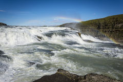 Gullfoss Waterfalls Iceland with the rainbow. Gullfoss Waterfalls Iceland and a spectacular rainbow Royalty Free Stock Image