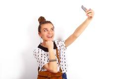 Gullig affärskvinna som poserar i studio Fotografering för Bildbyråer