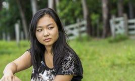 Gullig asiatisk flicka Arkivfoto