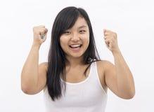 Gullig asiatisk flicka på isolerad bakgrund Fotografering för Bildbyråer