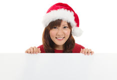 Gullig asiatisk julsanta kvinna Fotografering för Bildbyråer