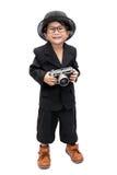 Gullig asiatisk pojke med tappningkameran Arkivfoto