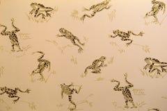 Gullig bakgrund av att hoppa grodor, en favorit av många dekoratörer royaltyfri fotografi