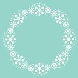 Gullig bakgrund för ram för runda för snöflingajulvinter Arkivfoto