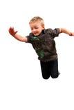 gullig banhoppning för pojke Royaltyfria Bilder