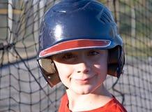 gullig baseballsmetpojke Arkivfoton