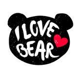 Gullig björnhuvudkontur med inskriften och röd hjärta Bokstävertext älskar jag björnen Arkivfoton