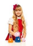 Gullig blond schoolgirl i labb Arkivfoton
