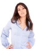 Gullig brunett i en blå skjorta Arkivbild