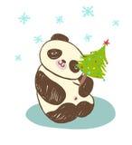 Gullig djur pandavinter med julgranen Arkivbild