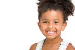 Gullig förskole- flicka som framme ler av vit bakgrund, kopia Royaltyfria Bilder