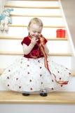 Gullig flicka i julklänning Royaltyfria Foton