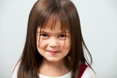 gullig flicka inomhus little Arkivfoto