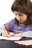gullig flicka little writing Fotografering för Bildbyråer