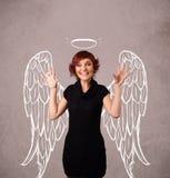 Gullig flicka med ängel illustrerade vingar Royaltyfri Fotografi
