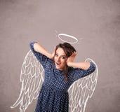 Gullig flicka med ängel illustrerade vingar Arkivfoton