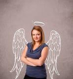 Gullig flicka med ängel illustrerade vingar Arkivbilder