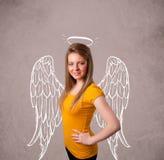 Gullig flicka med ängel illustrerade vingar Royaltyfria Foton
