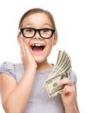 Gullig flicka med dollar Royaltyfri Bild