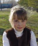 Gullig flicka med solbelyst hår Fotografering för Bildbyråer
