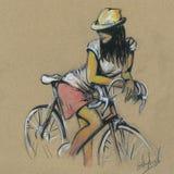 Gullig flicka på en cykel Teckna förbi handen Royaltyfri Fotografi