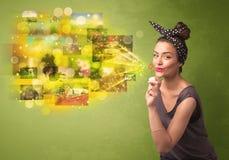 Gullig flicka som blåser färgglat glödande begrepp för minnesbild Arkivfoto