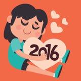 Gullig flicka som kramar det kommande nya året 2016 Arkivfoto