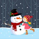 Gullig flicka som kysser en snögubbe Arkivfoto