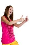 gullig flicka som visar upp tum royaltyfri bild