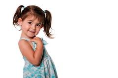 gullig flickapigtailslitet barn Arkivbild