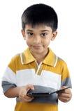 Gullig indisk pojke med telefonen royaltyfri bild