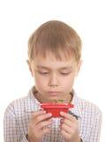 gullig isolerad seende ny växt för pojke Arkivbilder